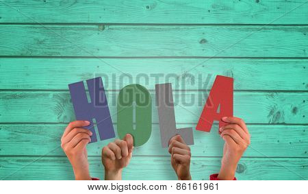 Hands holding up hola against digitally generated grey wooden planks