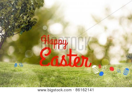 Happy Easter greeting against lights over green field