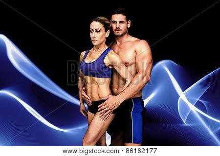 Bodybuilding couple against blue wave