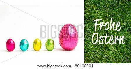 Frohe ostern against grass background