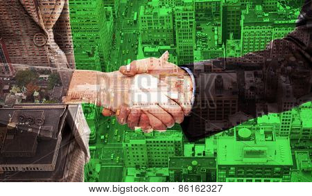 Close up of two businesspeople shaking their hands against new york