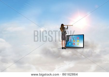 Businesswoman looking through a telescope against blue sky with white clouds