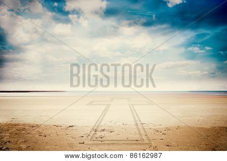 Cross against serene beach landscape