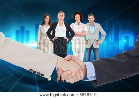 Smiling business people shaking hands while looking at the camera against blue bar chart graphic with light