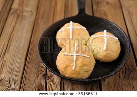 Hot Cross Buns In Cast Iron Skillet On Wooden Background