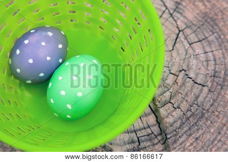 Two Dotted Eggs In Plastic Basket