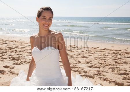 Bride Walking Along Sea Coast Wearing Beautiful Wedding Dress