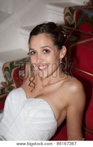 A Bride Is Sitting In Staircase