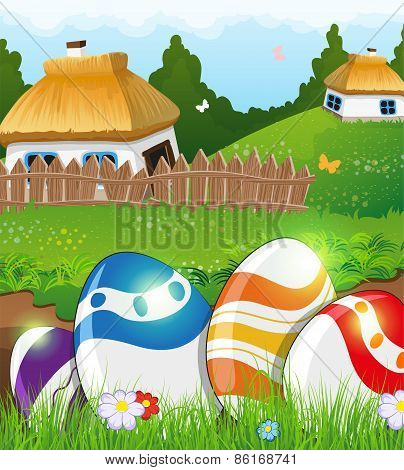 Easter Eggs In The Grass And Rural Houses