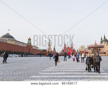 People And Tourists Walk On The Red Square In Moscow