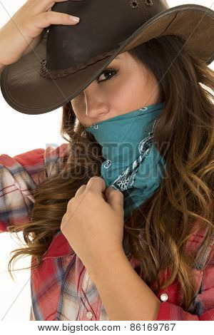 Cowgirl Close Hand On Hat And Bandana Over Face Looking