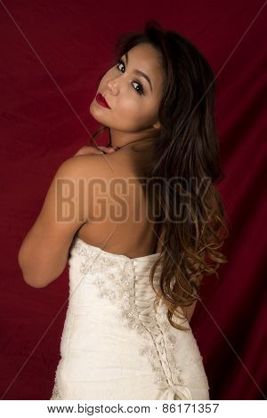 Woman In Wedding Dress Back Look On Red