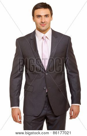 Well-dressed man in suit and tie. Charismatic businessman standing on white background