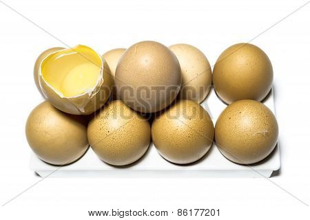 Raw Chicken Eggs On The Base And One Egg Is Broken