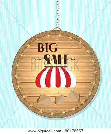One, isolated, hanging, wooden, round sign - with striped awning, shopping bags, text Big Sale