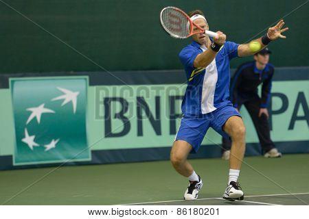 DNEPROPETROVSK, UKRAINE - APRIL 6, 2013: Robert Lindstedt, Sweden in the Davis Cup match Ukraine vs Sweden. Ukraine won the match 3-2