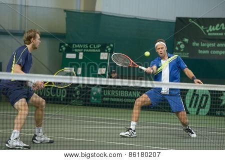 DNEPROPETROVSK, UKRAINE - APRIL 6, 2013: Robert Lindstedt (right) and Johan Brunstrom, Sweden in the Davis Cup match Ukraine vs Sweden. Ukraine won the match 3-2