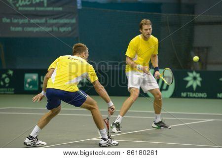 DNEPROPETROVSK, UKRAINE - APRIL 4, 2013: Robert Lindstedt (left) and Johan Brunstrom, Sweden on the training before Davis Cup match Ukraine vs Sweden. Ukraine won the match 3-2