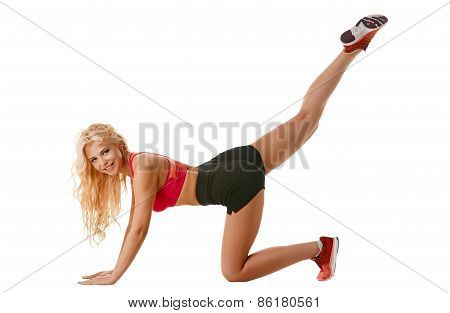 Beautiful girl stretching gluteal muscles