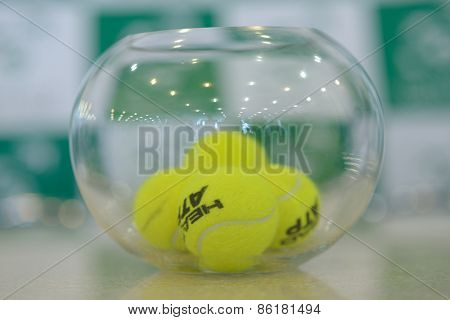 DNEPROPETROVSK, UKRAINE - APRIL 4, 2013: Tennis balls in the bowl during press conference before Davis Cup match Ukraine vs Sweden. Ukraine won the match 3-2