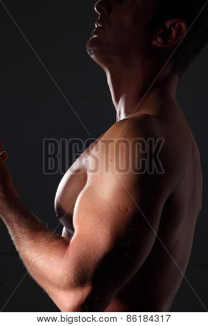 Portrait Muscular Man On Black Background
