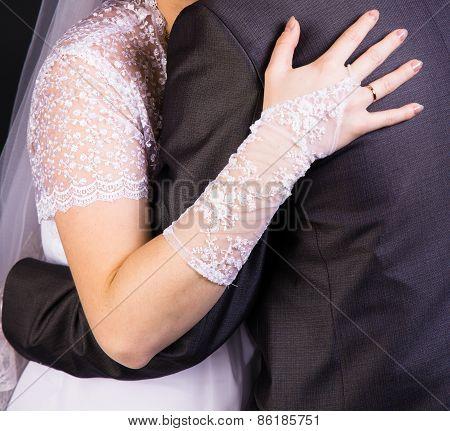 Bride Hand On The Back Of The Groom. Gentle Loving Hug