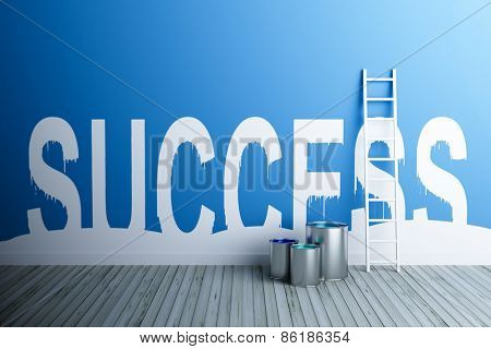 success paint on wall,with ladder and paint buckets by its side.success concept.