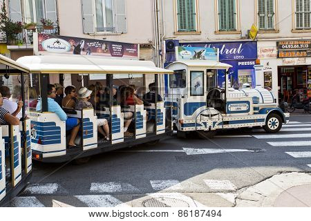 Tourists Enjoying A Tour On The Little Train In Cannes