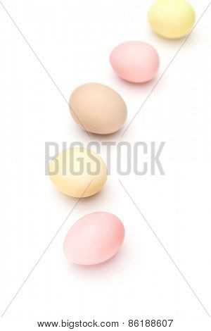 Rainbow of motley hen's eggs, isolated on white
