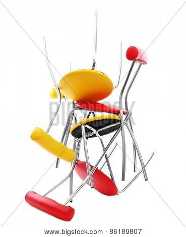 Stack of colorful chairs isolated on white