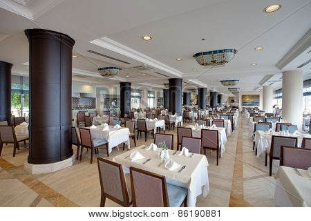 Interior of a restaurant in a hotel, during evening.