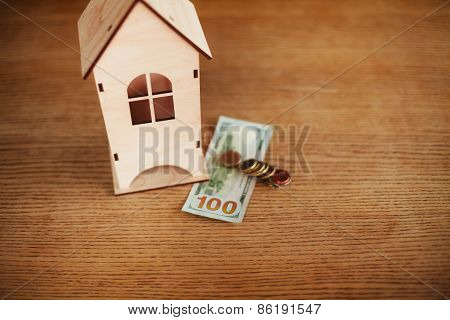 Model of house with money on the table