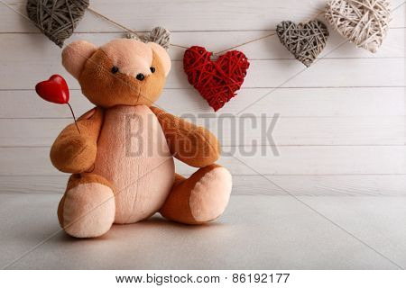 Teddy bear with hearts, love concept
