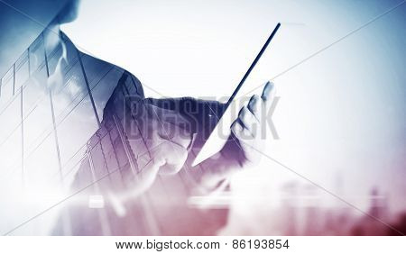 Double Exposure Of City And Hands Using Tablet