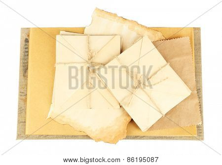 Old letters and book isolated on white