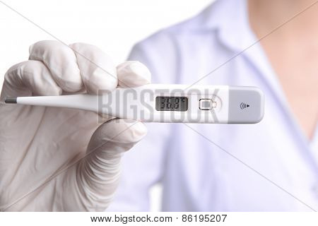 Doctor holding thermometer close up