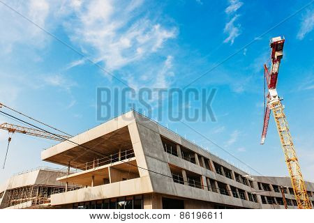 Construction Site With Cranes Over Blue Sky