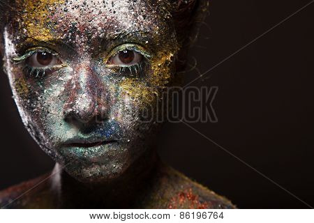 beautiful woman in bright color paint. with face art and body art.