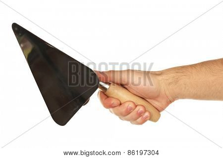 Building trowel in male hand isolated on white