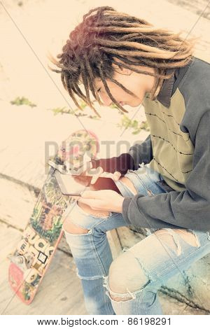 Young Rasta Guy Writing On A Tablet Warm Tones Applied