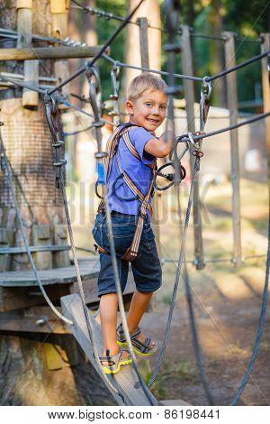 Boy in a climbing adventure park