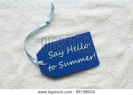 Say Hello To Summer On Blue Label Sand Background