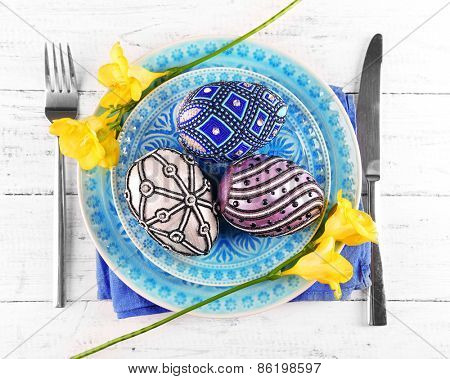 Easter table setting with Easter eggs close up