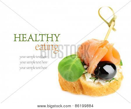 Canape with salmon, black olive and herbs isolated on white
