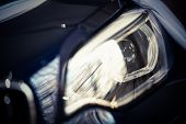picture of headlight  - Detail on one of the LED headlights of a car - JPG