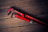 foto of pipe wrench  - vintage pipe wrench on a wooden background - JPG