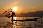 image of fishermen  - Traditional fisherman at Inle Lake during the sunset - JPG