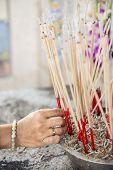 stock photo of graveyard  - joss stick pot at the graveyard - JPG