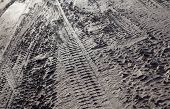 foto of boggy  - Wheel tracks on the dirt road after the rain - JPG