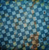 foto of chessboard  - Grungy blue dotted chessboard background with stains and scratches - JPG